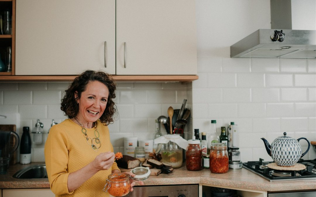 Audrey Dickinson nutrition therapist eating carrot ferment for gut health